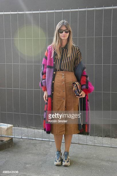 Fashion Blogger Clara Racz wears a vintage coat and skirt Patrizia Pepe shirt Diadora shoes and an Azzurra Gronchi bag on day 6 during Paris Fashion...
