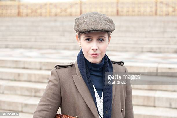 Fashion blogger Daniella Robins wears a Joseph coat Marks and Spencers hat Topshop bag and a Phillip Lim blazer day 3 of London Mens Fashion Week...