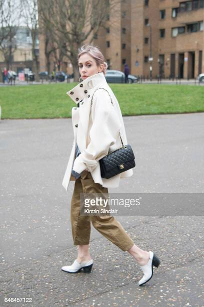 Fashion blogger Daniella Robins wears a TopShop coat Warehouse shoes Urban Outfitters trousers Marks and Spencers shirt and a Chanel bag on day 2 of...
