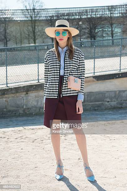 Fashion blogger Daria Rozina wears Zara bag Other Stories skirt HM hat and jacket and Zara shoes on day 4 of Paris Collections Women on March 06 2015...