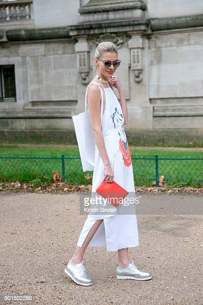 Fashion Blogger Dasha Gold wears a Furla bag Pared sunglasses Elect shoes Amy Christina Lawrance dress Lemon jewellery and Illesteva sunglasses on...