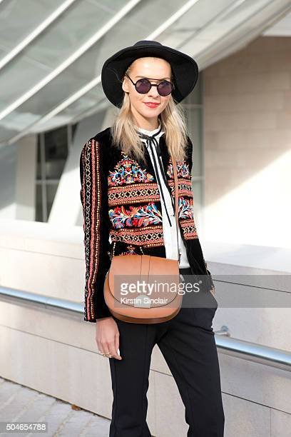 Fashion Blogger Dasha Gold wears Sachi shoes White suede trousers Zara jacket and a vintage hat on day 9 during Paris Fashion Week Spring/Summer...
