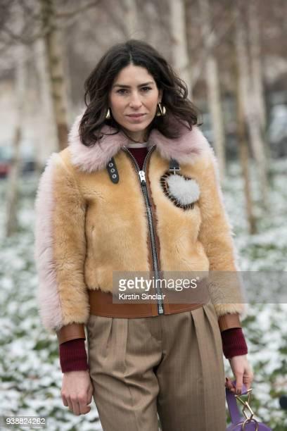Fashion blogger Deborah Reyner Sebag wears a Coach fur coat Max Mara trousers day 4 of Paris Womens Fashion Week Spring/Summer 2018 on March 1 2018...