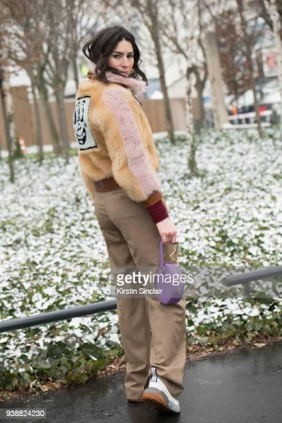 Fashion blogger Deborah Reyner Sebag wears a Coach fur coat Tara Zadeh bag Max Mara trousers and Stelle McCartney trainers day 4 of Paris Womens...