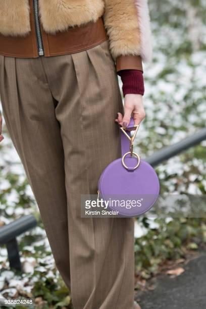Fashion blogger Deborah Reyner Sebag wears a Coach fur coat Tara Zadeh bag Max Mara trousers day 4 of Paris Womens Fashion Week Spring/Summer 2018 on...