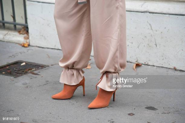 Fashion blogger Deea Codrea wears a Zara boots and H and M trousers day 6 of Paris Womens Fashion Week Spring/Summer 2018 on October 1 2017 in London...