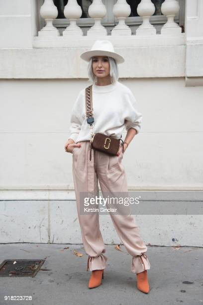 Fashion blogger Deea Codrea wears a Zara sweater and shoes Marc Jacobs bag H and M trousers and Vintage hat day 6 of Paris Womens Fashion Week...