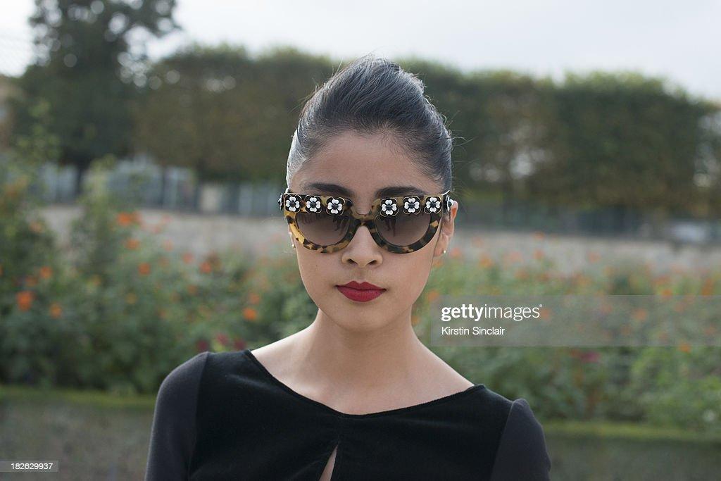 Fashion blogger Deni Elias wears an Elle Saab jumpsuit with Prada sunglasses on day 7 of Paris Fashion Week Spring/Summer 2014, Paris September 30, 2013 in Paris, France.