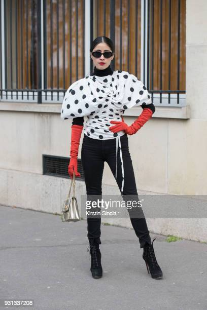 Fashion blogger Denni Elias wears a Jacquemus top Alaia shoes Dior bag and Topshop trousers day 2 of Paris Womens Fashion Week Spring/Summer 2018 on...