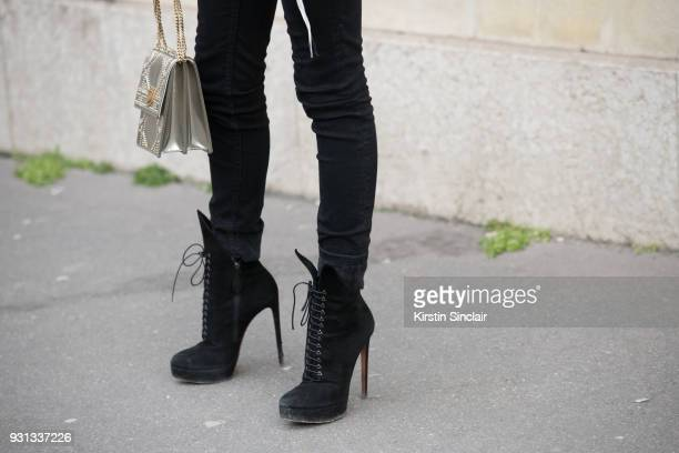 Fashion blogger Denni Elias wears Alaia shoes and Topshop trousers day 2 of Paris Womens Fashion Week Spring/Summer 2018 on February 27 2018 in...