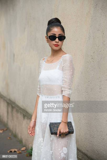 Fashion blogger Dennie Elias wears a Dior dress bag and underwear day 1 of Paris Womens Fashion Week Spring/Summer 2018 on September 26 2017 in...