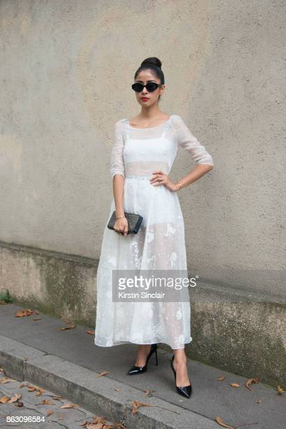 Fashion blogger Dennie Elias wears a Dior dress shoes bag and underwear day 1 of Paris Womens Fashion Week Spring/Summer 2018 on September 26 2017 in...