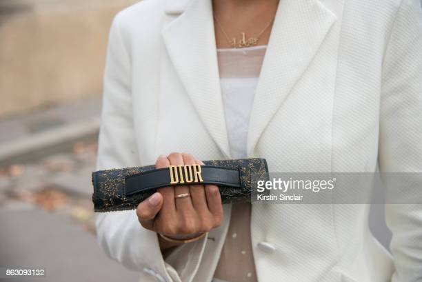 Fashion blogger Dennie Elias wears a Dior jacket dress and bag day 1 of Paris Womens Fashion Week Spring/Summer 2018 on September 26 2017 in London...