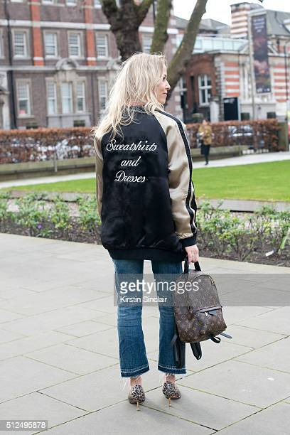 Fashion blogger Diana BellHeather wears a Zara bomber jacket Louis Vuitton bag and Prada shoes on day 3 during London Fashion Week Autumn/Winter...