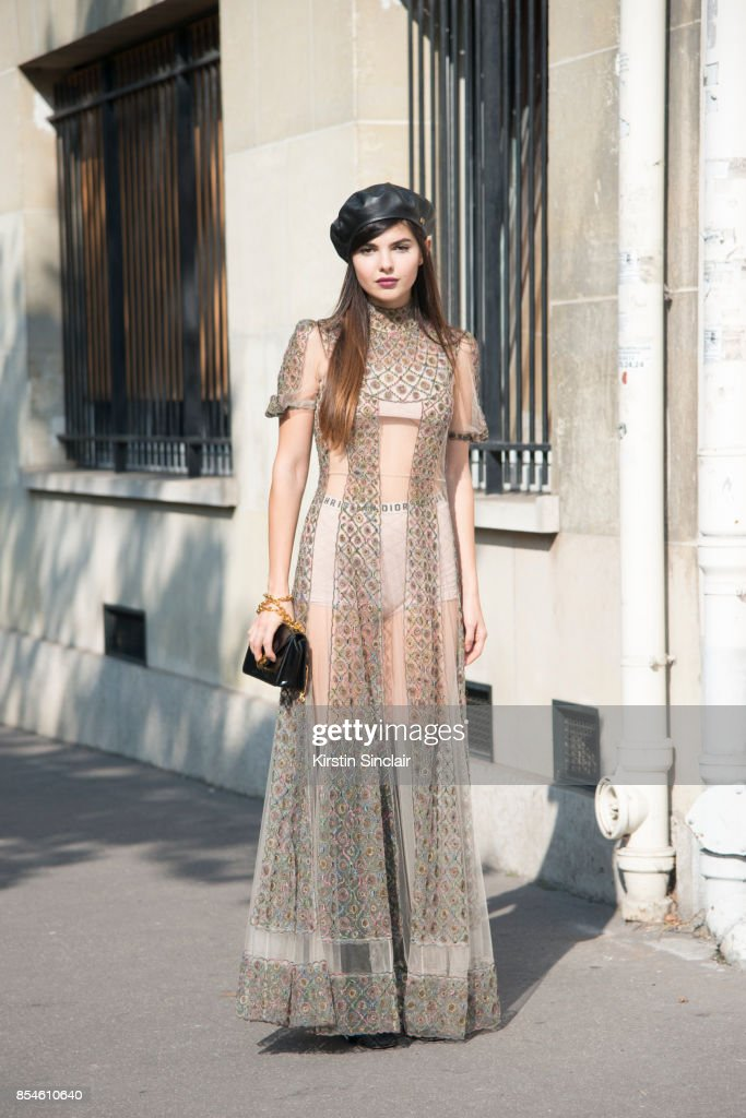 Fashion blogger Diona Ciobanu wears a Dior dress, hat, bag, shoes and underwear day 1 of Paris Womens Fashion Week Spring/Summer 2018, on September 26, 2017 in Paris, France.