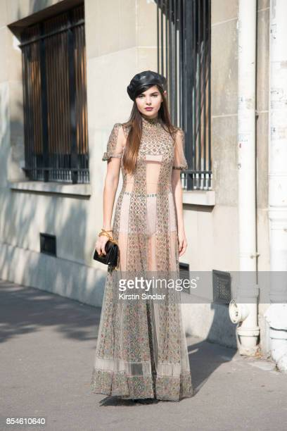 Fashion blogger Diona Ciobanu wears a Dior dress hat bag shoes and underwear day 1 of Paris Womens Fashion Week Spring/Summer 2018 on September 26...
