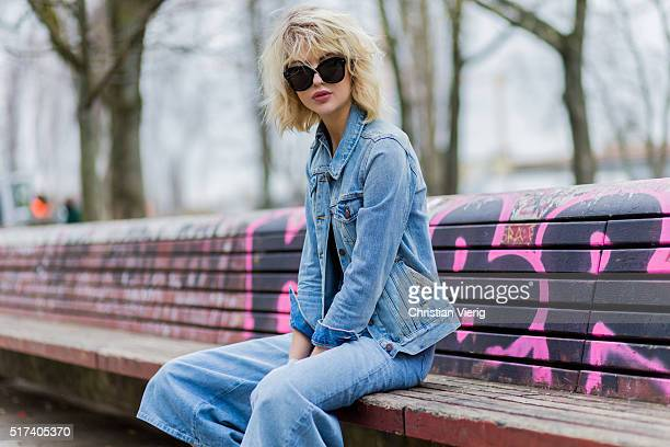 Fashion blogger Ebba Zingmark wearing a blue denim jacket 7 8 wide jeans black sunglasses a black cropped top on March 24 2016 in Berlin Germany
