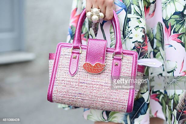 Fashion blogger Eleonora Carisi is seen wearing a Topshop dress and Patrizia Pepe X Eleonora Carisi bag before Missoni show on June 22 2014 in Milan...