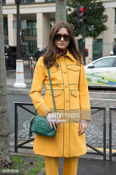 Fashion Blogger Eleonora Carisi wears a Fendi suit with a Gucci bag on day 9 during Paris Fashion Week Autumn/Winter 2016/17 on March 9 2016 in Paris...