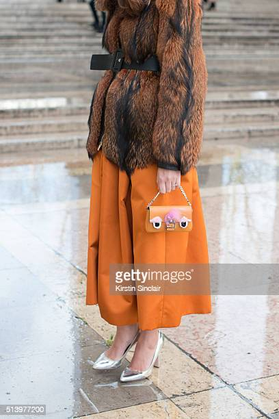 Fashion blogger Eleonora Carisi wears Bluemarine dress and coat Fendi bag and Paula Cademartori shoes on day 2 during Paris Fashion Week...