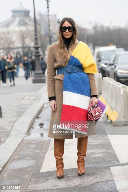 Fashion blogger Elisa Taviti wears Ralph Lauren boots Valentino bag Pace Style Concept coat Asos scarf Céline sunglasses and a Miu miu belt day 4 of...