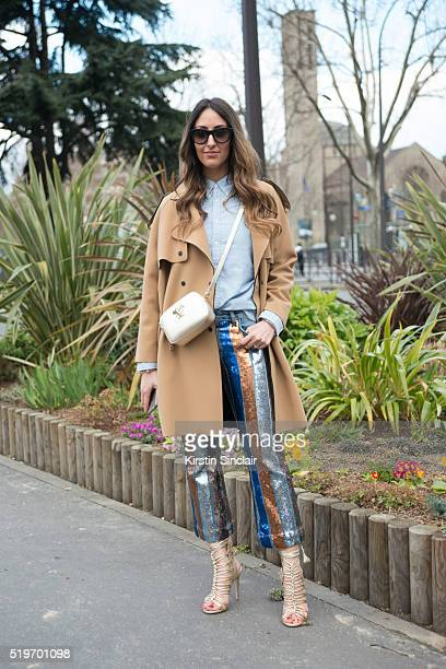 Fashion Blogger Elisa Taviti wears Versace bag Polo shirt Espace Mode Coat trousers and shoes on day 6 during Paris Fashion Week Autumn/Winter...
