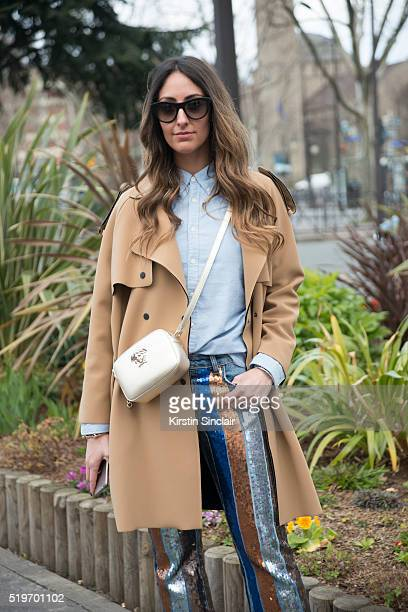 Fashion Blogger Elisa Taviti wears Versace bag Polo shirt Espace Mode Coat and trousers on day 6 during Paris Fashion Week Autumn/Winter 2016/17 on...
