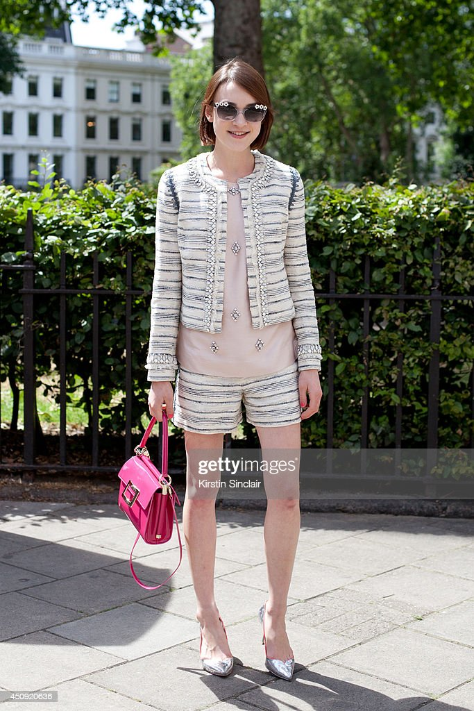 Fashion Blogger Ella Catliff wears a Tory Burch suit, Sophia Webster shoes, Christopher Kane top, Roger Vivier bag and Kate Spade sunglasses on day 3 of London Collections: Men on June 17, 2014 in London, England.