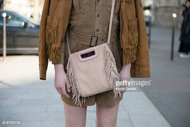 Fashion Blogger Ella Catliff wears Ralph Lauren dress and jacket and Maje bag on day 6 during Paris Fashion Week Autumn/Winter 2016/17 on March 6...