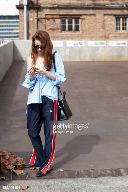 Fashion Blogger Ella Janee is wearing a Topshop top Le Coq pants Gucci shoes Kenzo bag and Sabre Eyewear Sunglasses during MercedesBenz Fashion Week...