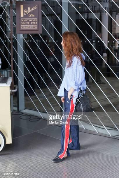 Fashion Blogger Ella Janee is wearing a Topshop top Le Coq pants Gucci shoes Kenzo bag and Sabre Eyewear Sunglasses during MercedesBenz Fashion Week...