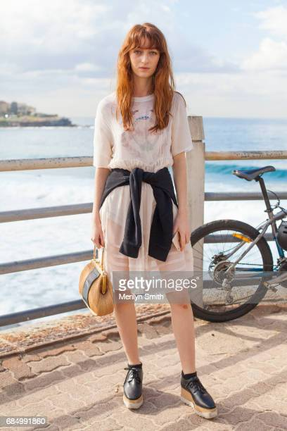 Fashion Blogger Ella Janee wearing a vintage tshirt and bag Benetia Clane dress Topshop sweater and Stella McCartney shoes during MercedesBenz...