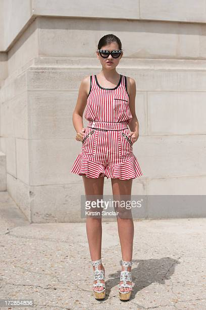 Fashion blogger Elvira Rezzonico wears Prada sunglasses Three Floor playsuit and Jimmy Choo shoes on day 2 of Paris Collections Womens Haute Couture...