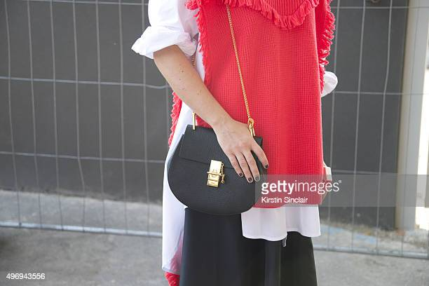 Fashion Blogger Emilie Higle wears a Chloe bag and boots Kenzo sweater and Shiatzy Chen skirt on day 6 during Paris Fashion Week Spring/Summer...