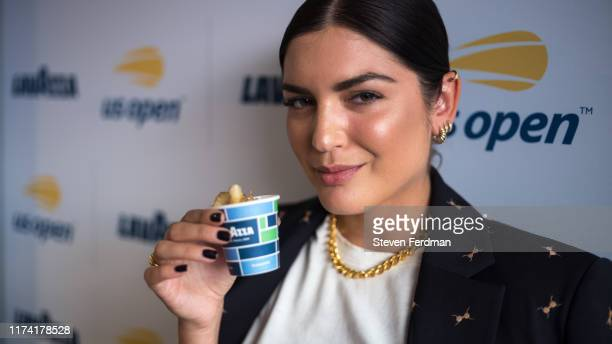 Fashion blogger Emily Luciano enjoys coffee in the Lavazza Lounge during the 2019 US Open at Arthur Ashe Stadium on September 08 2019 in New York City