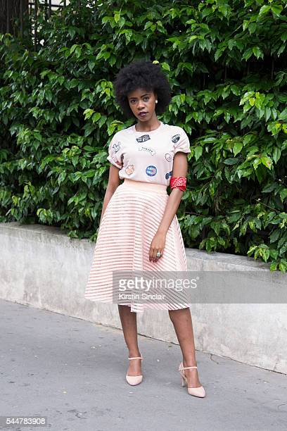 Fashion Blogger Emmaude Mpanzu wearing a Bershka Top New Look skirt and shoes and a vintage scarf on day 1 of Paris Haute Couture Fashion Week...