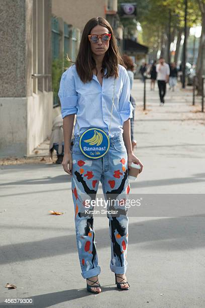 Fashion Blogger Erika Boldrin is wearing her boyfriend's shirt Levi's jeans Oui Odile bag and Kyme sunglasses on day 6 of Paris Collections Women on...