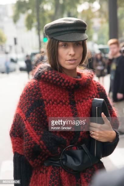 Fashion blogger Erika Boldrin wears a Balenciaga bag Wolford cape Isabel Marant hat and belt day 2 of Paris Womens Fashion Week Spring/Summer 2018 on...