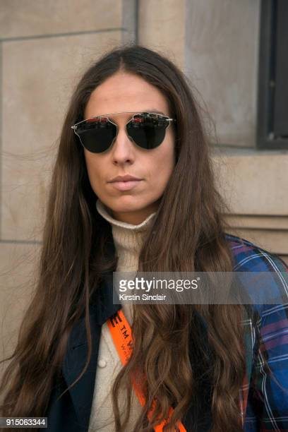 Fashion blogger Erika Boldrin wears a JW Anderson for Uniqlo coat and Gentle Monster sunglasses day 5 of Paris Womens Fashion Week Spring/Summer 2018...
