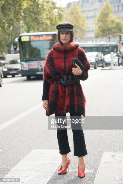 Fashion blogger Erika Boldrin wears Balenciaga shoes trousers and bag Wolford cape Isabel Marant hat and belt day 2 of Paris Womens Fashion Week...