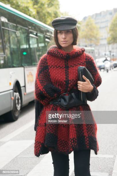 Fashion blogger Erika Boldrin wears Balenciaga trousers and bag Wolford cape Isabel Marant hat and belt day 2 of Paris Womens Fashion Week...