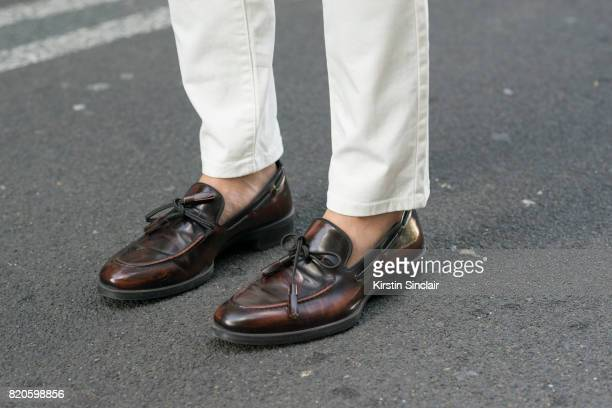 Fashion blogger Erwin Trinidad wears Next trousers and Zara shoes on day 3 of London Collections Men on June 11 2017 in Paris France