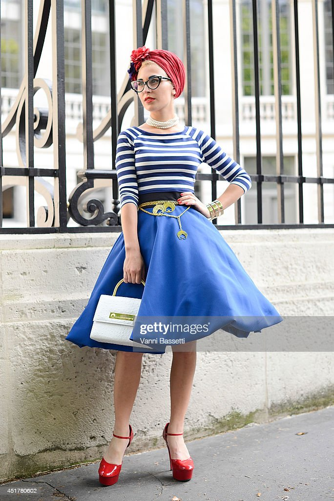 Fashion blogger Eva Ana Kazic poses wearing a B. Polanec skirt, All around Eve bag and jewelry and Different Eyewear x All around Eve glasses before Atelier Versace show on July 6, 2014 in Paris, France.