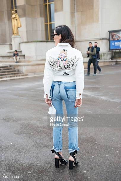 Fashion blogger Evangelie Smyrniotaki wears an Olympia Le Tan jacket Vetements jeans NGR sunglasses and Dior shoes on day 4 of Paris Haute Couture...
