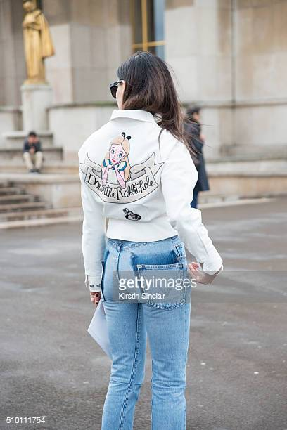 Fashion blogger Evangelie Smyrniotaki wears an Olympia Le Tan jacket Vetements jeans and NGR sunglasses on day 4 of Paris Haute Couture Fashion Week...