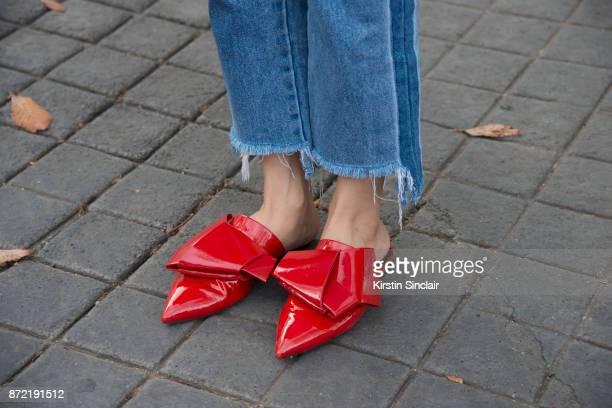 Fashion blogger Faye Tsui wears Stella Luna shoes day 4 of Paris Womens Fashion Week Spring/Summer 2018 on September 29 2017 in London England