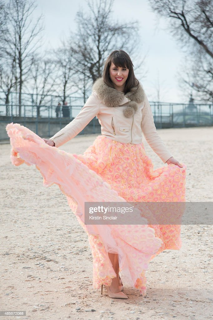 Fashion blogger Festy wears an H and M jacket and Priston dress on day 5 of Paris Collections: Women on March 07, 2015 in Paris, France.