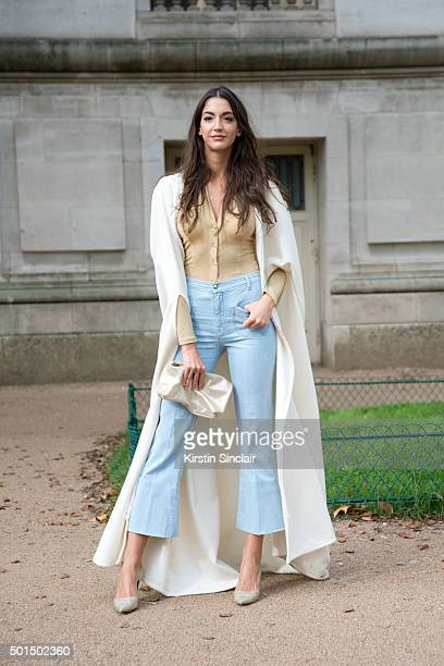 Fashion blogger from the Lipstick Sisters Sara Nicole wears Alberto Guardiani shoes 7 jeans vintage top Violet bag and The Lipstick Sisters cape on...