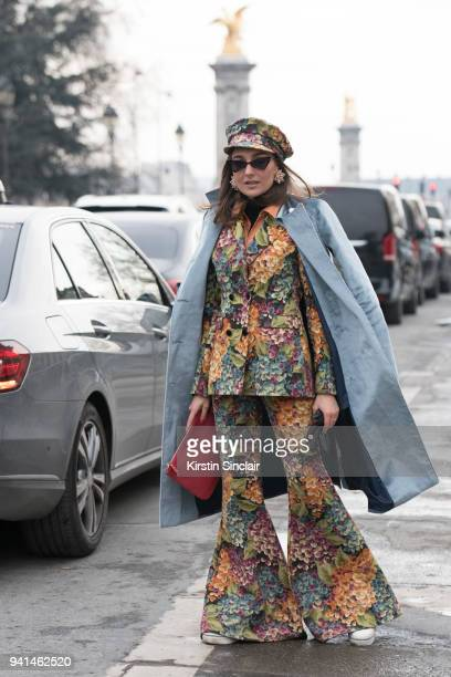 Fashion blogger Gabriela Atanasov wears L'oeil sunglasses Stefanel bag and a Sweet Paprika suit day 4 of Paris Womens Fashion Week Spring/Summer 2018...