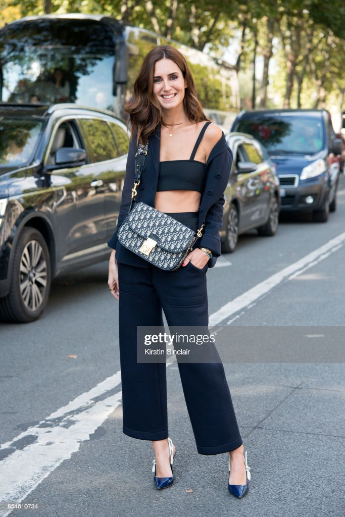 Fashion blogger Gala Gonzalez wears a Dior suit, top, bag and shoes day 1 of Paris Womens Fashion Week Spring/Summer 2018, on September 26, 2017 in Paris, France.